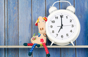 Stuffed animal giraffe and clock for bedtime